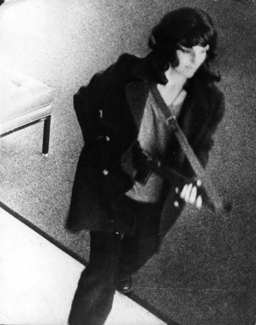 Patty Hearst, on surveillance cameras, February 12th, 1974. A surveillance camera catches American newspaper heiress Patty Hearst during a bank robbery in San Francisco in 1974. She was kidnapped by the Symbionese Liberation Army on Feb. 4 of that year; later joined her kidnappers in this bank robbery; and was imprisoned for almost two years before President Jimmy Carter commuted her sentence.