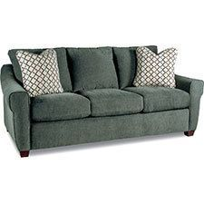 Give your home a modern makeover with our Keller Premier sofa. It's roomy comfort you can share, with updated curves and classic good looks; it makes a stylish statement that invites relaxing. Featuring unique sloping arms, warm wood feet and two matching accent pillows, it will give your room a beautiful new focal point.
