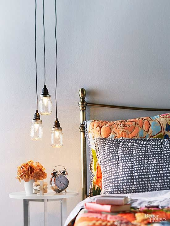 Instantly illuminate your bedside with a series of pendant lights made from canning jars. Purchase socket lights that plug into a standard outlet so you won't have to worry about electrical work. Cut a hole in the jar lid and tuck the light into the jar, then hang from a hook. /