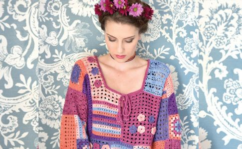 The squares with flower trims make this top interesting and a pleasure to crochet