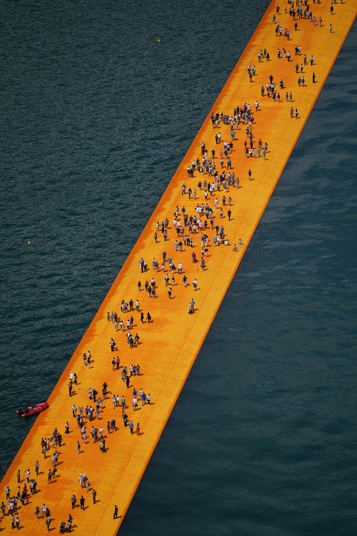 Christo's Floating Piers opens on Lake Iseo in Italy allowing visitors to walk on water