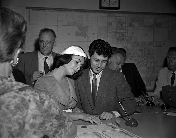 Las Vegas, Nevada- Elizabeth Taylor and Eddie Fisher gaze at their marriage license which they obtained right after Fisher was granted a divorce from Debbie Reynolds. The couple will be married here and fly immediately to New York on their way to Europe. #elizabethtaylor #actresses #vintage #celebrities #1950s #1960s #1970s