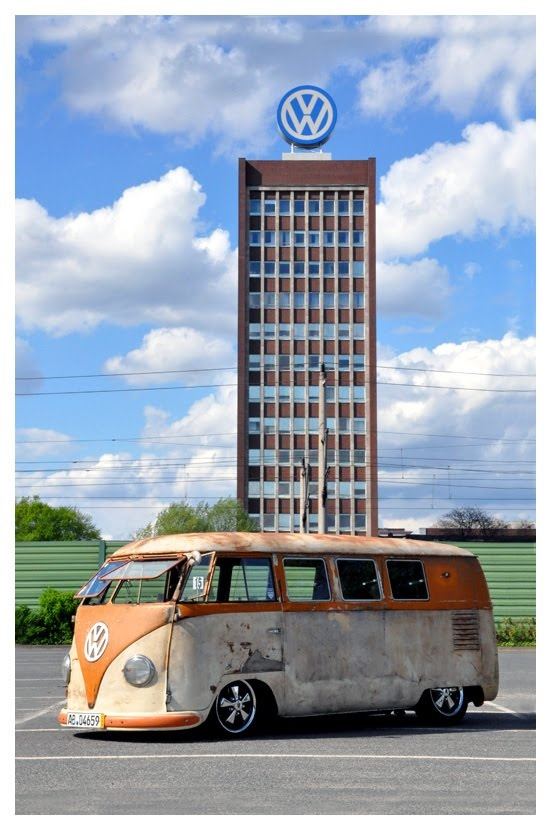 old ratty orange T1 vw bus, in front of Volkswagen building ♠ re-pinned by http://www.wfpblogs.com/category/toms-blog/