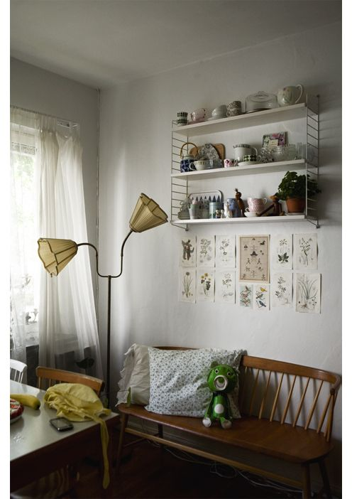 vintage swedish ceramics in a String shelf | Home of Lisa Marie Andersson, designer behind the clothing label Up The Wooden Hills | Photo: Fine Little Day