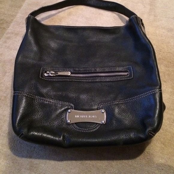 Michael Kors black purse Black Michael Kors purse with inside zipper pocket and cell phone holder. Pocket in the outside front for easy convenience. Michael Kors Bags