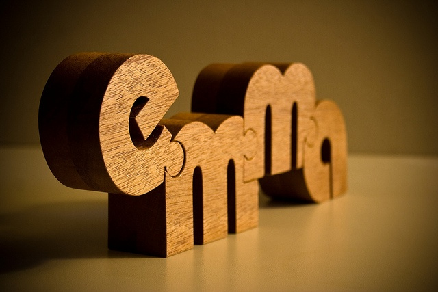 Nuzzle -- name puzzle made of single piece of wood.