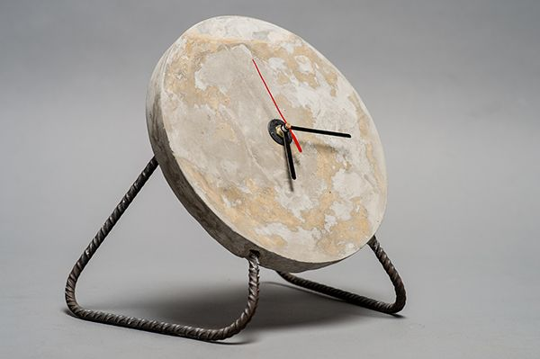 An handmade project of a concrete table clock. Does it look like the moon?
