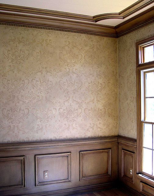 Beautiful wood details and trimmings with damask walls.