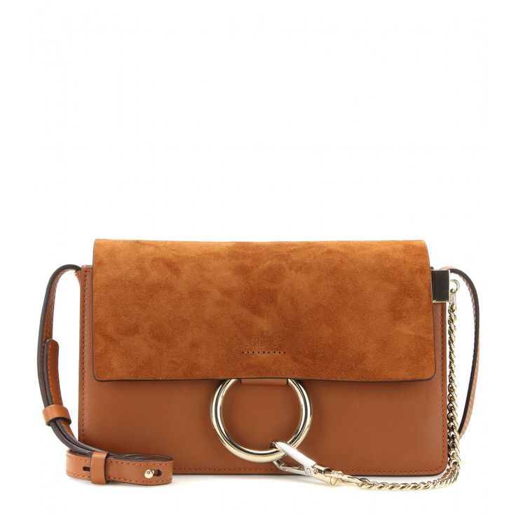 Chloé - Faye Small leather and suede shoulder bag - We love this petite addition to the 'Faye' family. Complete with everything we love about the original - the suede flap contrasted against smooth leather, gold and silver-tone hardware - it's the perfect demonstration of Chloé's modernly feminine appeal. Take yours anywhere and everywhere as the ultimate final touch to your look. seen @ www.mytheresa.com