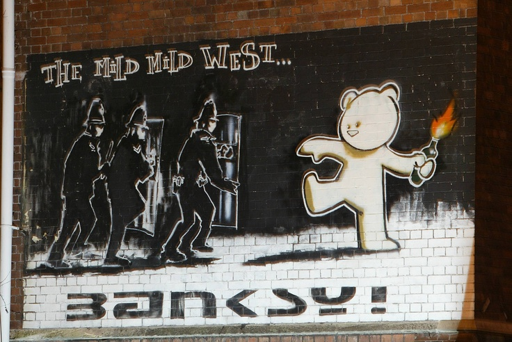 Banksy's Mild Mild West mural on the wall of Hamilton House in Stokes Croft, Bristol.