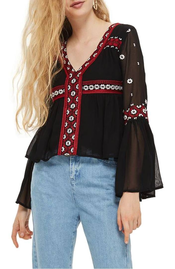Intricately embroidered panels add a free-spirited, boho accent to this wispy top styled with billowing fluted sleeves to perfect the folksy look. Topshop Embroidered Flute Sleeve Top available at Nordstroms.