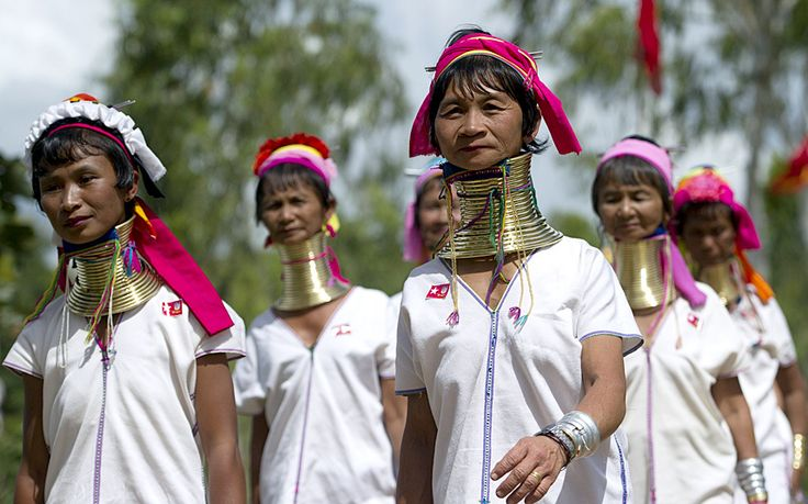 Padaung ethnic women arrive to listen the speech of Myanmar opposition leader Aung San Suu Kyi, Chairperson of National League for Democracy (NLD) party, during her first official election campaign at Demoso township of Kayah State, eastern Myanmar