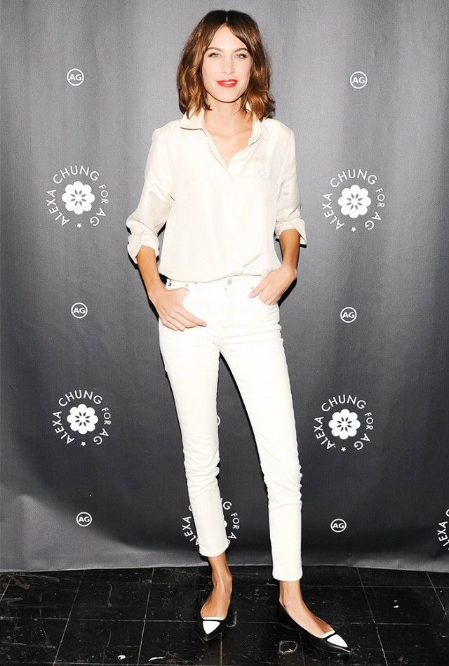 Alexa Chung wearing a slouchy button-down blouse + cropped skinny jeans + pointed-toe flats