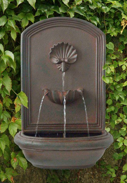 Seaside outdoor wall fountain style beachy pinterest for Outdoor wall fountains
