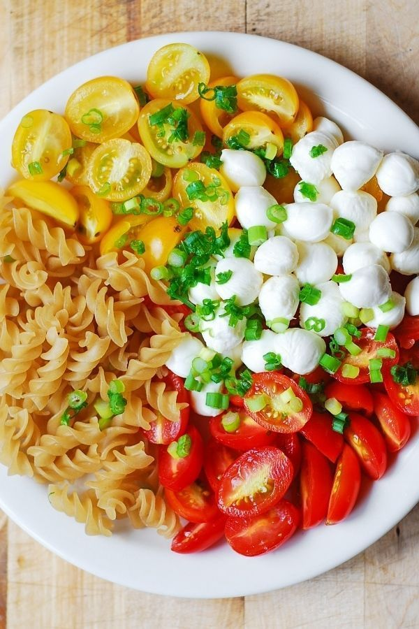 Toss together a tasty and healthy pasta salad recipe with roasted tomatoes, mozzarella cheese and a pinch of basil. This is a great lunch recipe to prepare ahead of time and have the whole week or bring to a potluck or picnic gathering for a healthy side dish!