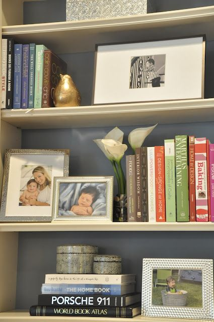 Bookshelf styling. Place some books upright, while others are horizontal. Interupt books with photos and other art objects.