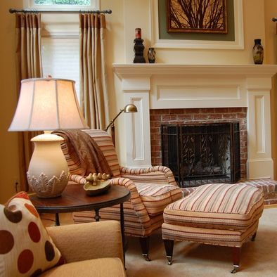 Brick Fireplace Remodel - I like the idea of letting some of the original brick peek through, but surrounded by detailed moldings.