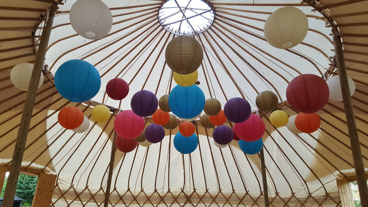 Loving Yurts this week! Our second Yurt, this time the chillout/party yurt. We loved creating this colourful canopy so much fun. At night the lanterns change as they are individually lit with some colour changing buttonlites mixed in. #yurt #hanginglanterns #weddinglighting #lanternlove #eventprofs #wedding