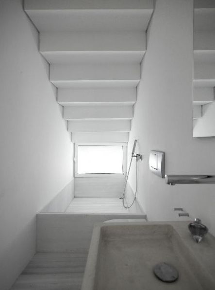 inspirational images and photos of small space living remodelista bathroom under stairsdownstairs