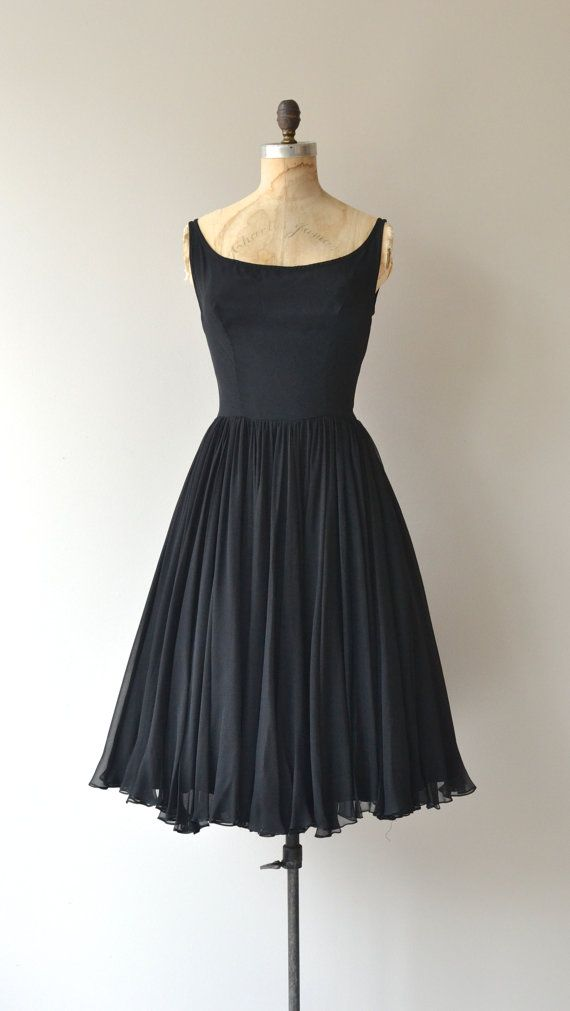 So classic. As lovely and elegant today as it was 50 years ago. An exceptional little black dress, vintage late 1950s, early 1960s Pat Sandler silk layered cocktail dress with fetching wide set shoulder straps and scoop neckline, nipped waist and airy layers of silk chiffon skirt. Metal back zipper.