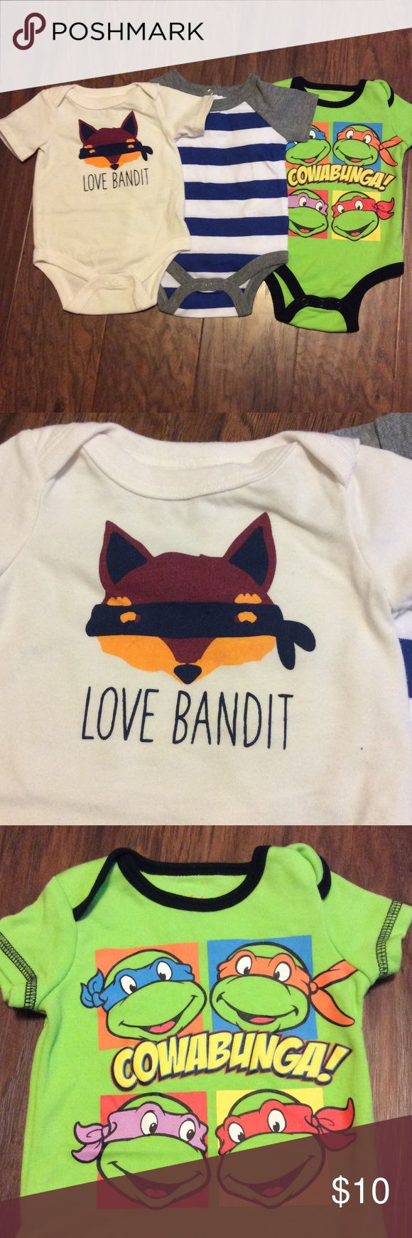 "3-pc Newborn Onesies--TMNT, Love Bandit, Etc. Three various onesies.  First is an off-white with raccoon print and ""love bandit"", by Circo.  Second is navy/white stripe with heather gray trim by Circo.  Third is Ninja Turtles with black trim on bright green by Nickelodeon.  All 100% cotton in excellent condition.  See my other listings to combine shipping and get a discount!  Thanks for looking! :) Various One Pieces Bodysuits"