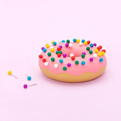 this desktop delight is guilt-free. why? because it's not real! this desk donut by fred and friends doubles as a push pin holder and eraser (and can also be used to play multiple pranks on coworkers..