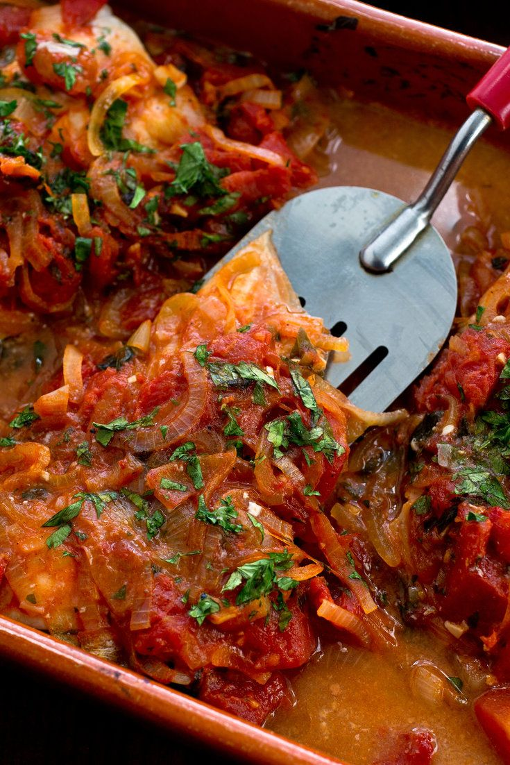 Greek baked fish with tomatoes and onions recipe greek for Best fish marinade