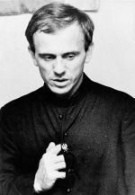 Father Jerzy Popieluszko; the cassock has a sign of a crowned white eagle pinned in the cassock.