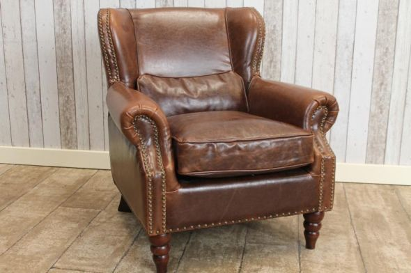 This studded leather armchair is a fantastic addition to our vast range of quality vintage and reproduction furniture. These beautiful superb quality...