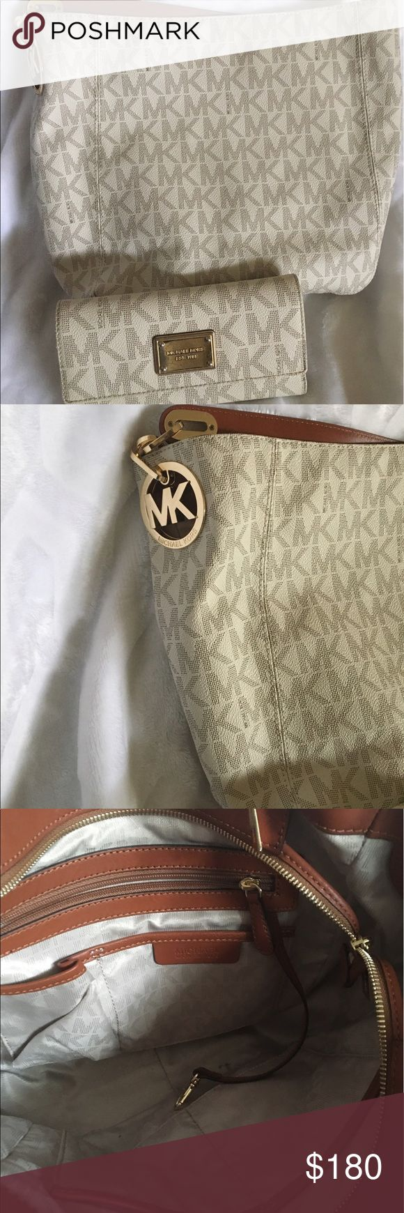 """Michael Kors Fulton vanilla monogram set Selling as a set OR separate. As a set the price is $180 (includes dust bag) The purse alone is $150 (includes dust bag) The wallet alone is $38 Dust bag included.   Purse dimensions: 14"""" wide 10"""" tall 7"""" strap drop Very cute medium sized bag!  The wallet is in good condition but it has some scratching on the metal. No pen or checkbook included. I will ship same day if purchased before 9am. Michael Kors Bags Shoulder Bags"""