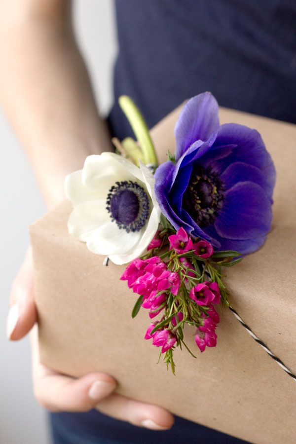 A fresh idea? Add beautiful flowers to simple kraft paper gift wrap.