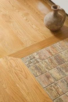 Several options are available when transitioning from tile to wood flooring.