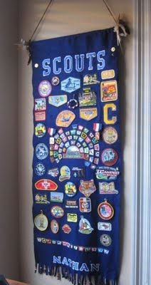 Banner Display.  Would be a great gift for graduating Webelos :) Not too sure all of our boys' stuff would fit. Might have to make it a fleece blanket.