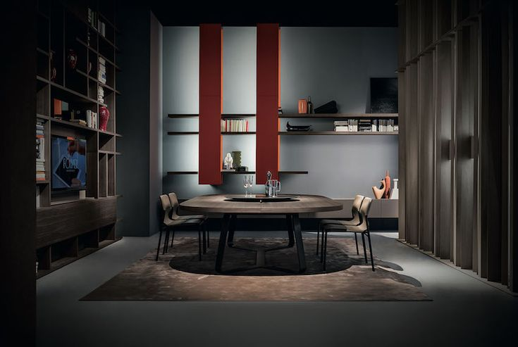 Modern dining room set with oval wooden dining table and wooden dining chairs. It looks incredibly elegant in this dark, modern dining room but we are sure it can fill a mid-century modern interior as well. 10 Awesome Modern Dining Room Sets That You Will Adore ➤ Discover the season's newest designs and inspirations. Visit us at  www.moderndiningtables.net #diningtables #homedecorideas #diningroomideas @ModDiningTables