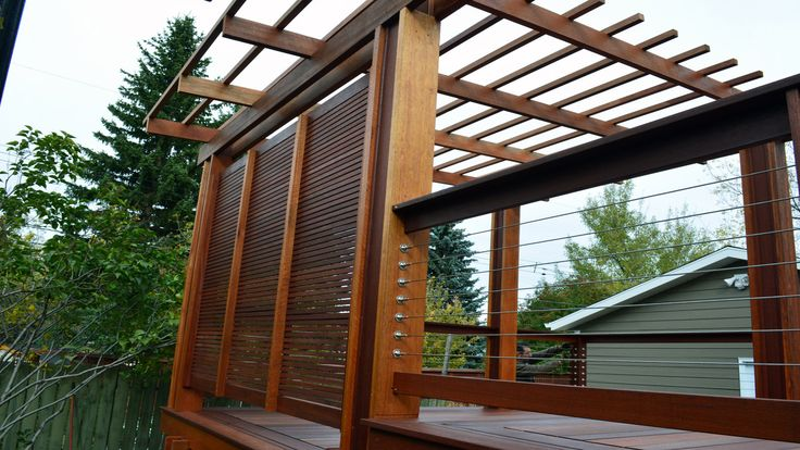 Beautiful privacy screen and pergola in Calgary, Alberta made from Red Balau Batu supplied by Kayu Canada Inc.