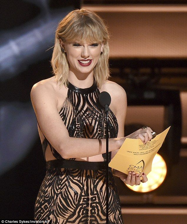 She's back! Taylor Swift made her return to the Country Music Association Awards on Wednesday night - and got the crowd talking with her daring choice of outfit