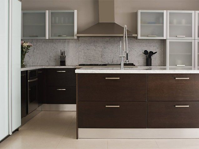 A sleek modern kitchen design featuring grey upper for Sleek modern kitchen cabinets
