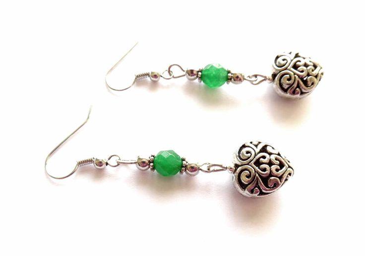 Örhängen med pärlor av smaragd