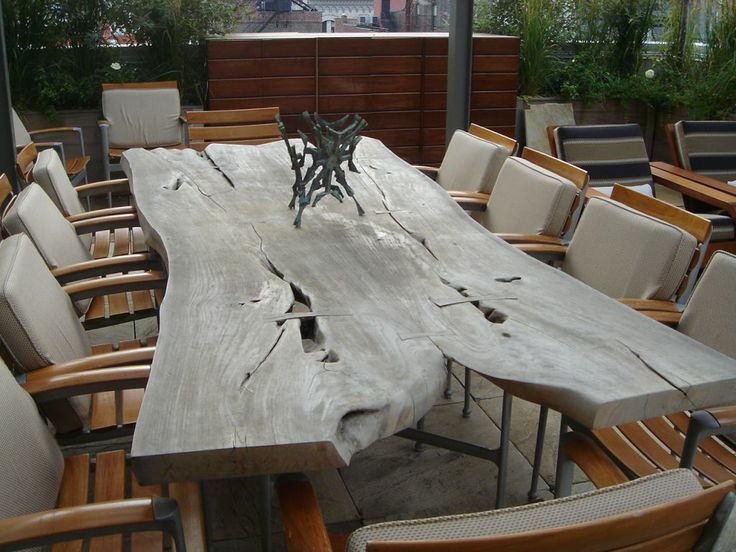 A Long Free Form Ipe Wood Slab Table And Twelve Chairs