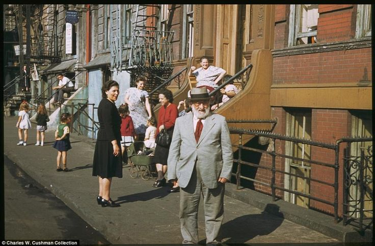 Residents of lower Clinton St near the East River on a Saturday afternoon in September 1941.  I love this picture!!!