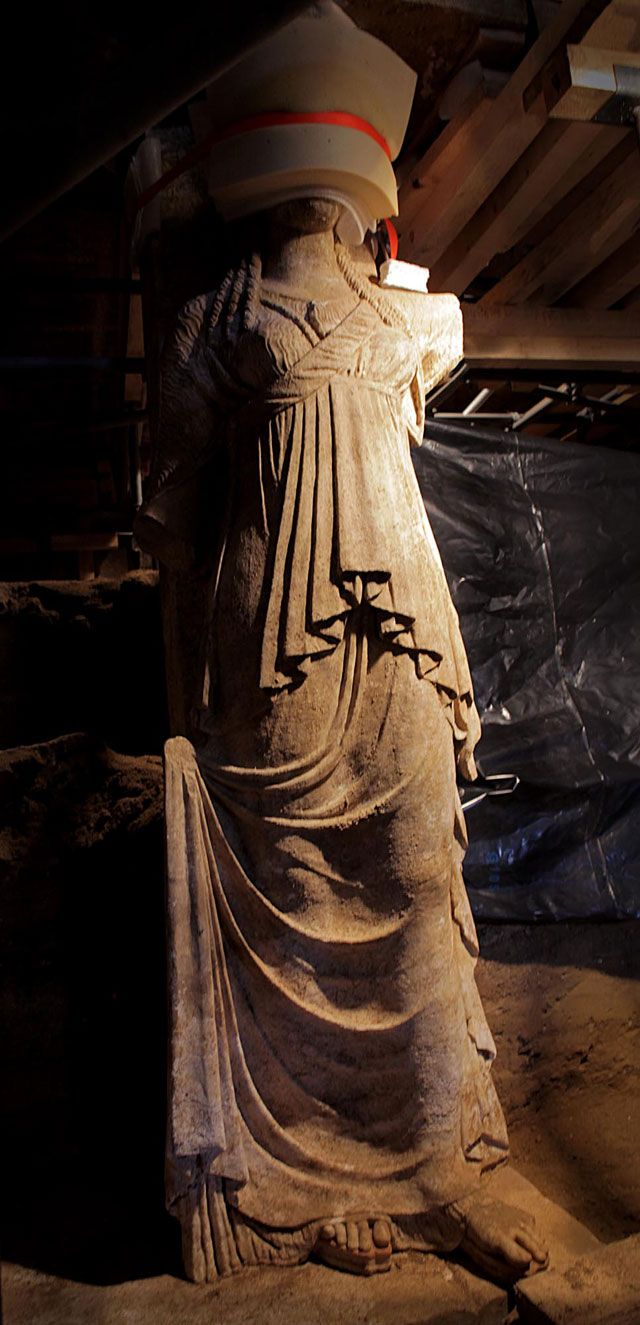 By Sept. 21, the caryatids had been revealed down to their feet.