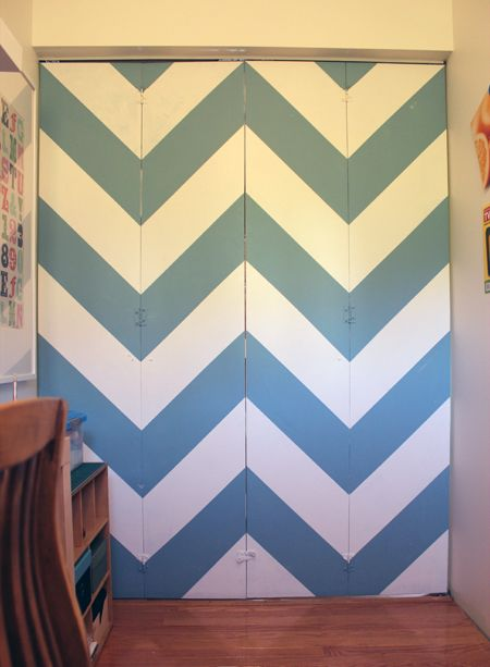 Chevron striped bi-fold office door makeover from FlutterFlutter. I have awful gold-trimmed, mirrored closet doors. Maybe I can change them to bifold and paint!