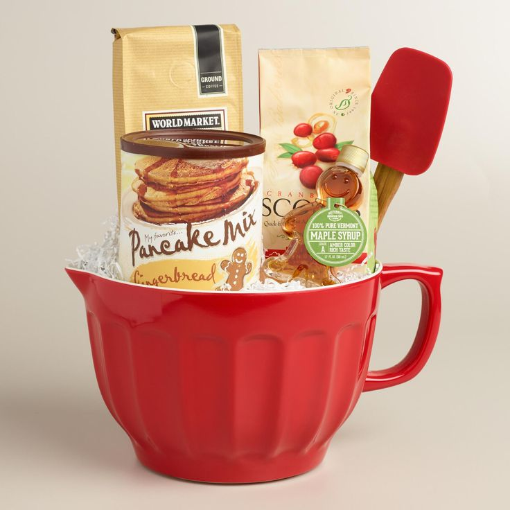 Breakfast-themed gift pack includes an assortment of coffee, pancake and scone mix, syrup and a spatula to whip it all together. Packed in a mixing bowl, this wholesome breakfast basket makes a thoughtful housewarming or holiday gift.