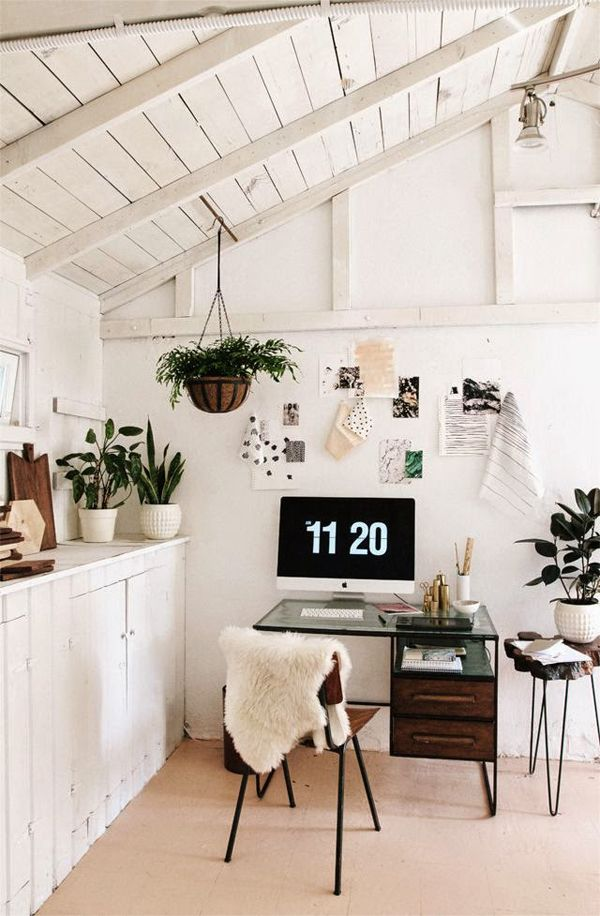 those potted plants and hanging basket fern give this minimalistic white office a breath of fresh air.