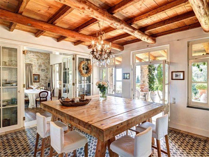 The chandelier adds a hint of glamour to the rustic old world charm