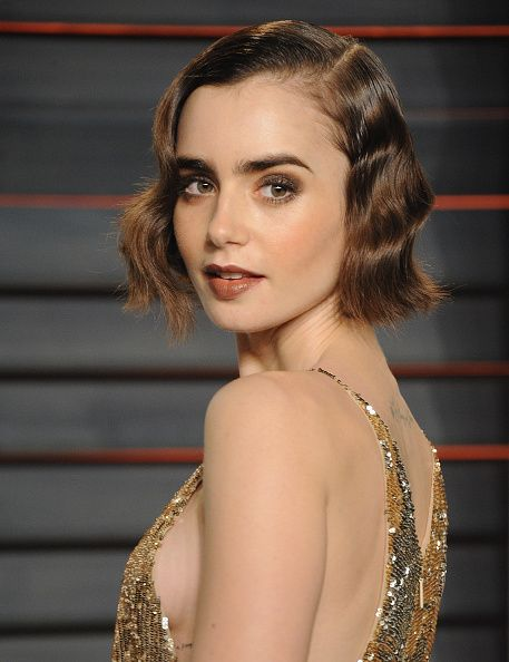 Actress Lily Collins arrives at the 2016 Vanity Fair Oscar Party Hosted By Graydon Carter at Wallis Annenberg Center for the Performing Arts on...