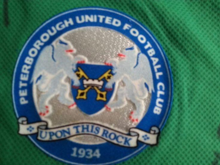 Peterborough united signed football shirt whole Team.