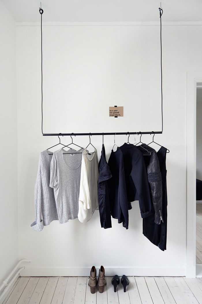 Clothing rack idea  via nordicdesign.ca.  Maybe on a pulley to move it out of the way...