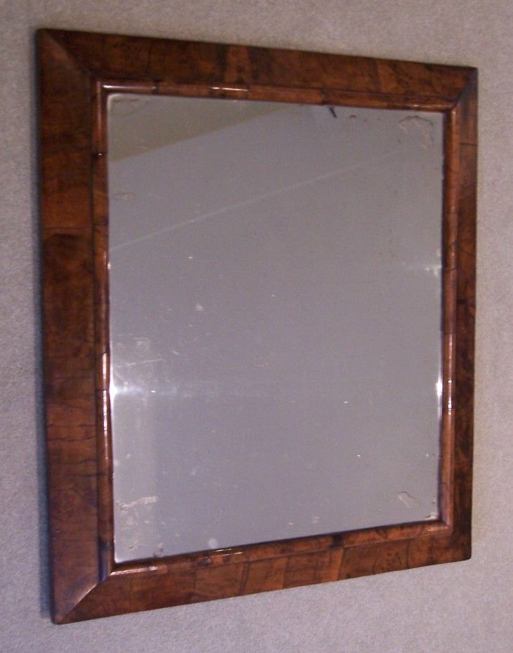 Queen Anne Walnut Bevel frame Mirror of excellent original colour, the mercury plate probably a good Early 19th Century replacement.  This form of bevel frame was a variant on the cushion frame.  FOR SALE, see http://www.domani-devon.com/stock/mirrors/queen-anne-walnut-mirror