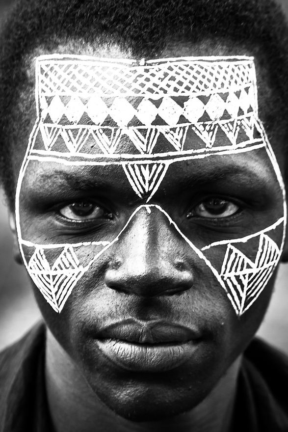 Man from Africa with intricate face painting